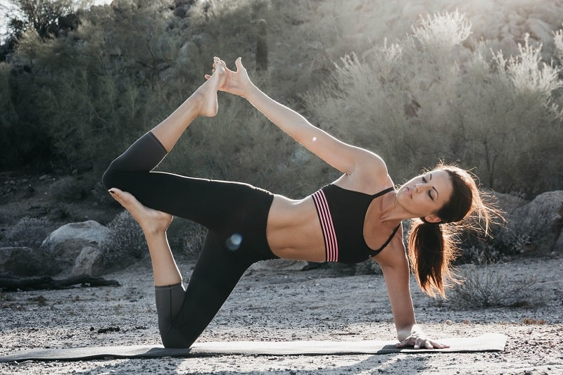 woman in side plank variation on knee