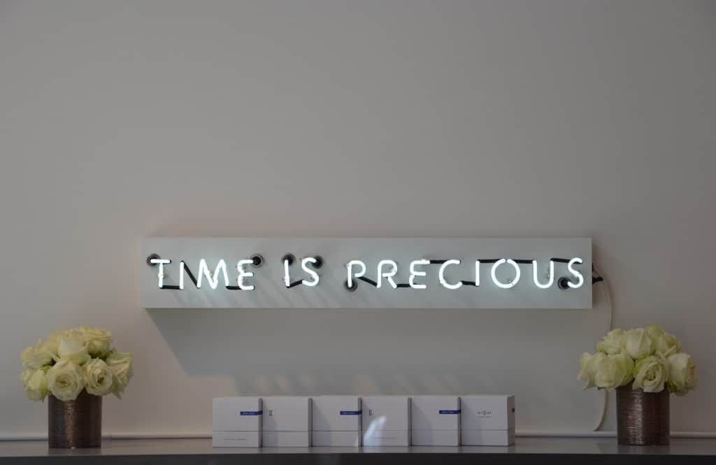 time is precious neon sign