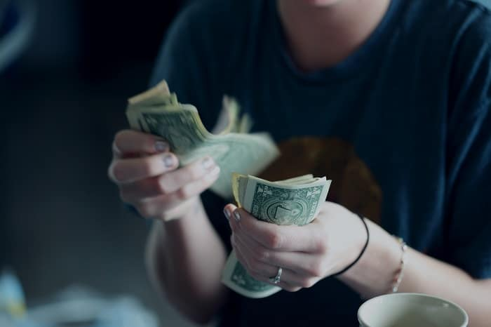 person counting money
