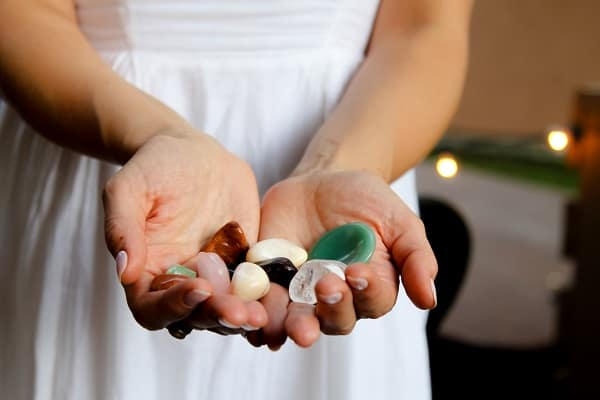 woman holding crystals